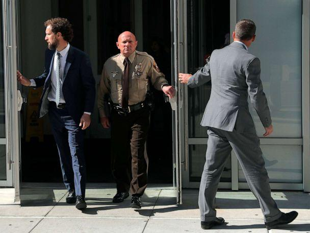 PHOTO: SSt. Louis County police Sgt. Keith Wildhaber, center, flanked by his attorneys Sam Moore, left, and Russell Riggan leave the St. Louis County justice center, Oct. 22, 2019, in Clayton, Mo. (Laurie Skrivan/AP, FILE)