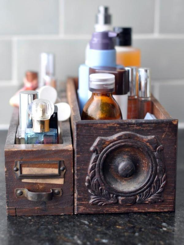 """<div class=""""caption-credit""""> Photo by: HGTV.com</div><b>Drawer Storage</b> <br> Rather than using baskets or boxes, thrift some random drawers (like old sewing machine desk drawers or library card file boxes) and stuff with all your bathroom toiletries. <br> <b><a rel=""""nofollow noopener"""" href=""""http://blogs.babble.com/the-new-home-ec/2012/05/23/easy-feng-shui-2/"""" target=""""_blank"""" data-ylk=""""slk:Related: 8 ways to feng shui your home"""" class=""""link rapid-noclick-resp""""><i>Related: 8 ways to feng shui your home</i></a></b>"""