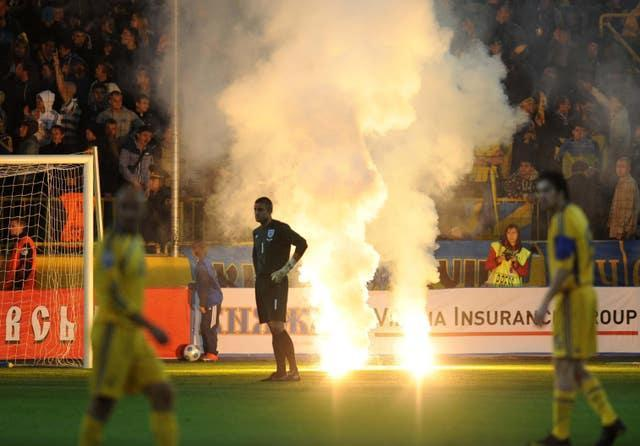 Robert Green looks away as flares are let off during England's match against Ukraine in Dnipropetrovsk (Owen Humphreys/PA).