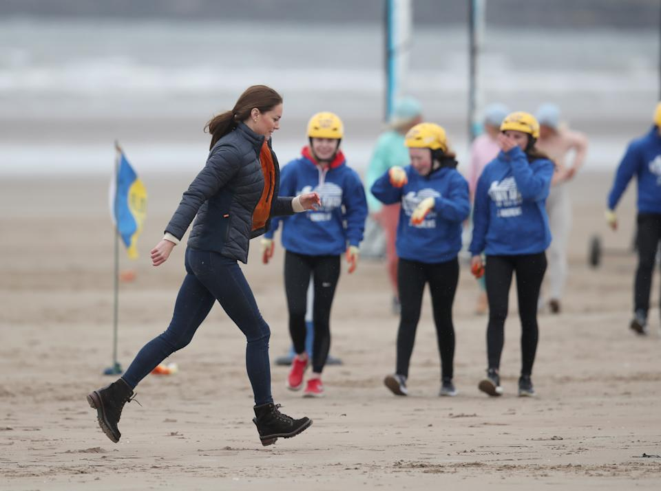 EMBARGOED UNTIL 1050 WEDNESDAY MAY 26 The Duchess of Cambridge with a group of young carers land yachting on the beach at St Andrews. Picture date: Wednesday May 26, 2021.
