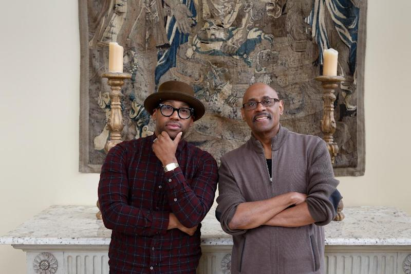 """This Dec. 26, 2013 photo shows Bishop Paul Morton, right, and his son PJ Morton in New Orleans. The Mortons are nominated for best gospel album for """"Best Days Yet,"""" the elder Morton's album where PJ wrote and produced four songs. PJ's song, the Stevie Wonder-featured """"Only One,"""" is also up for best R&B song. The Mortons are the first to accomplish the feat since Bob and Jakob Dylan did so in 1998. (AP Photo/Doug Parker)"""