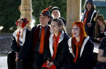 A group of participants listen to instructions during a workshop before the role play event at Czocha Castle in Sucha, west southern Poland April 9, 2015. REUTERS/Kacper Pempel
