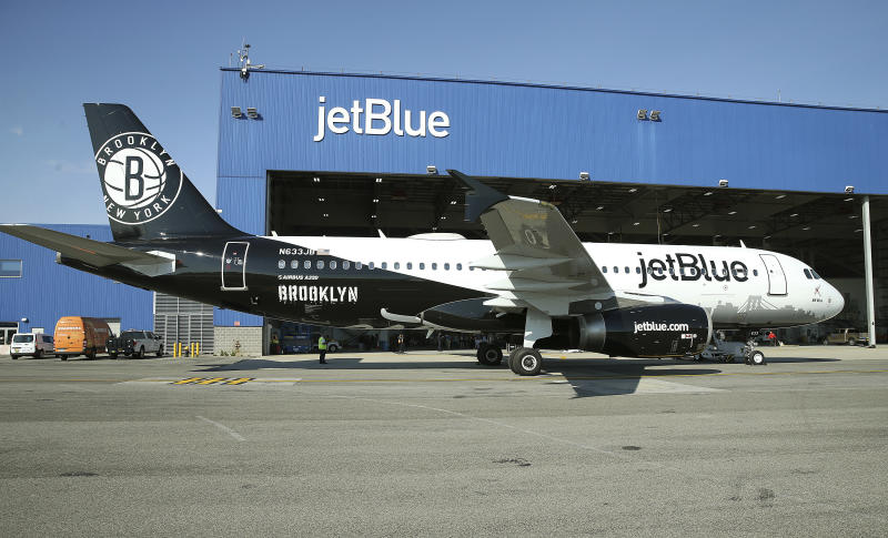 IMAGE DISTRIBUTED FOR JETBLUE - JetBlue reveals its newest aircraft BK Blue which is dedicated to the Brooklyn Nets on Thursday, Nov. 1, 2018 in New York. (Donald Traill/JetBlue via AP Images)