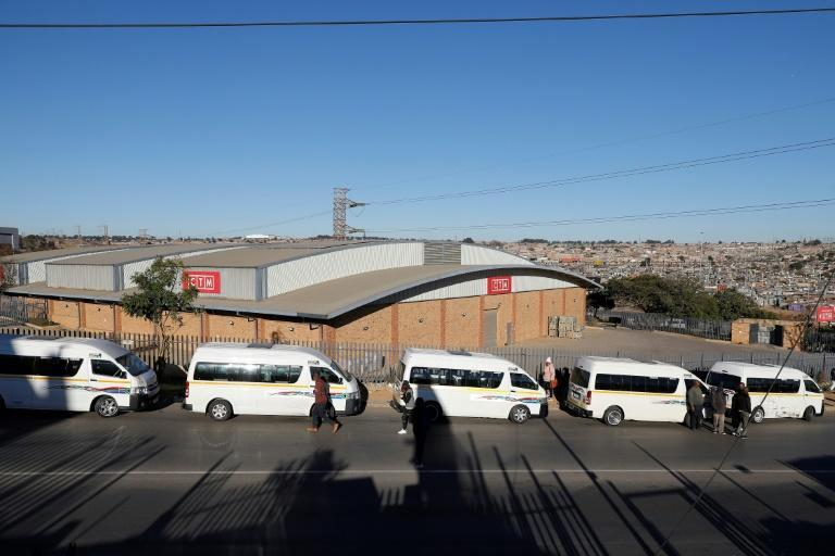 Taxi drivers block the entrance to a shopping mall in Tembisa, north of Johannesburg, in an attempt to shield it from looters