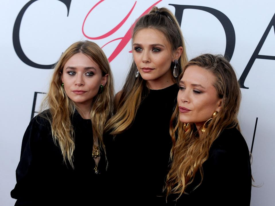 Photo by: Dennis Van Tine/STAR MAX/IPx 2016 6/6/16 Ashley Olsen, Elizabeth Olsen and Mary-Kate Olsen at the 2016 CFDA Fashion Awards. (NYC)