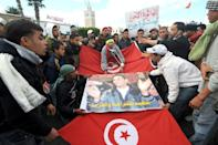 The Tunisia protests were triggered when an impoverished street vendor set himself alight
