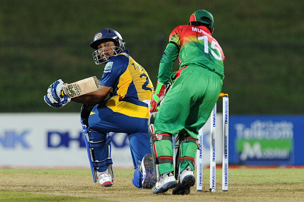 Sri Lankan cricketer Tillakaratne Dilshan (L) plays a shot as Bangladesh cricket captain Mushfiqur Rahim (R) looks on during the opening one-day international (ODI) match between Sri Lanka and Bangladesh at The Suriyawewa Mahinda Rajapakse International Cricket Stadium in the southern district of Hambantota on March 23, 2013.  Sri Lankan cricket captain Angelo Mathews  won the toss and elected to field. AFP PHOTO/ Ishara S. KODIKARA        (Photo credit should read Ishara S.KODIKARA/AFP/Getty Images)