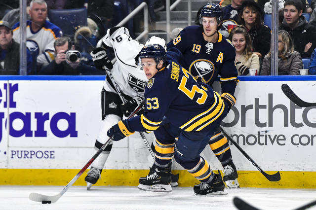 Buffalo Sabres left wing Jeff Skinner (53) skates the puck away from Los Angeles Kings center Adrian Kempe during the second period of an NHL hockey game in Buffalo, N.Y., Saturday, Nov. 21, 2019. (AP Photo/Adrian Kraus)