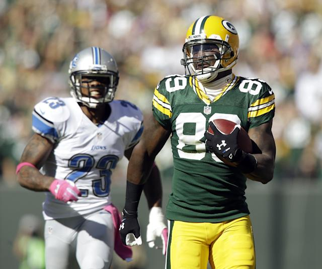 Green Bay Packers' James Jones breaks away from Detroit Lions' Chris Houston (23) for an 83-yard touchdown catch during the second half of an NFL football game Sunday, Oct. 6, 2013, in Green Bay, Wis. (AP Photo/Jeffrey Phelps)