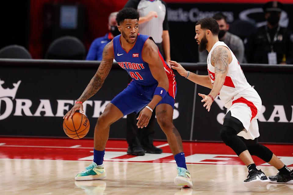 Detroit Pistons forward Saddiq Bey (41) dribbles the ball against Toronto Raptors guard Fred VanVleet (23) during the first quarter at Little Caesars Arena on March 17, 2021.