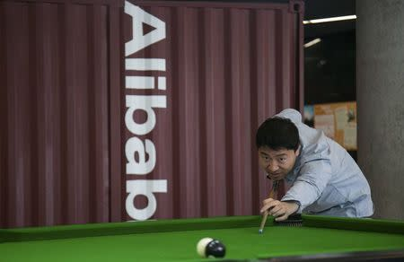 A man plays snooker in a hall inside Alibaba's headquarters in Hangzhou, Zhejiang province, April 23, 2014. REUTERS/Chance Chan