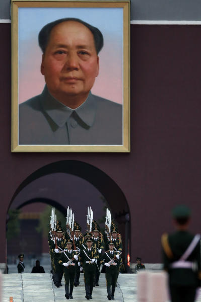 Chinese paramilitary policemen march under a portrait of former Chinese leader Mao Zedong to a flag lowering ceremony on Tiananmen Square in Beijing, China, Wednesday, Nov. 7, 2012. The Chinese Communist Party's 18th National Congress is scheduled to begin Nov. 8 in the Chinese capital. In addition to selecting members of leading party bodies, the 2,270 delegates hear and deliberate over the work of the party over the last five years, a party discipline report and revisions to the party constitution. (AP Photo/Ng Han Guan)