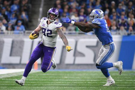 Dec 23, 2018; Detroit, MI, USA; Minnesota Vikings tight end Kyle Rudolph (82) is tackled by Detroit Lions outside linebacker Christian Jones (52) during the second half at Ford Field. Mandatory Credit: Tim Fuller-USA TODAY Sports