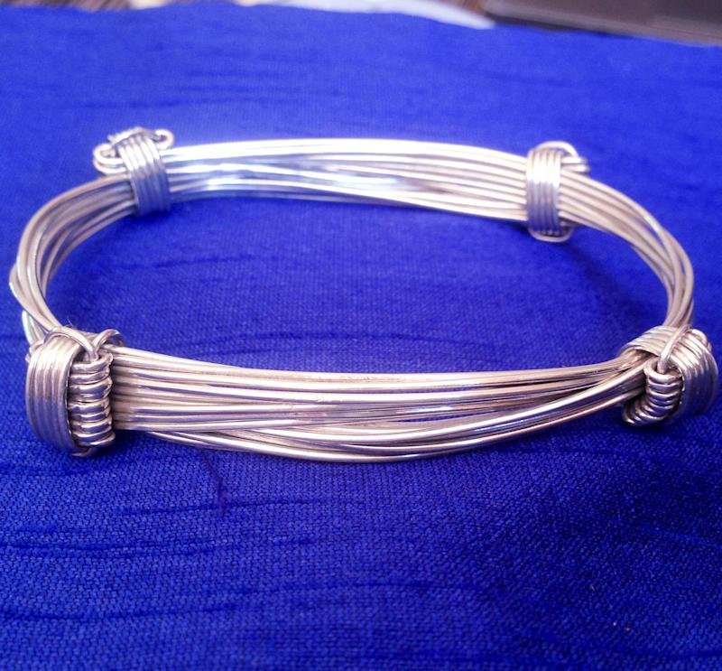 Elephant adjustable bangle in silver. Heavier 9 thread bangle