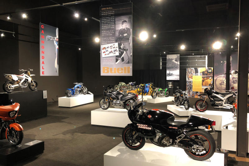 Motorcycles sit in an exhibition hall at the Graceland tourist attraction on Wednesday, May 22, 2019, in Memphis, Tenn. The collection of motorcycles spans decades and is one of three new exhibits set to open at Elvis Presley's Graceland. (AP Photo/Adrian Sainz)