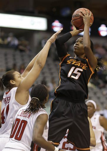 Oklahoma State forward Toni Young (15) shoots against Texas Tech guard Chynna Brown (00) and forward Kelsi Baker (41) during the first half of an NCAA college basketball game in the Big 12 Conference tournament Saturday March 9, 2013, in Dallas. (AP Photo/LM Otero)