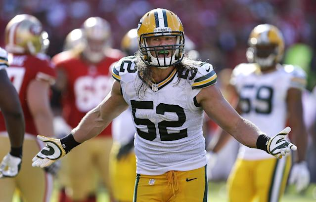 FILE - In this Sept. 8, 2013 file photo, Green Bay Packers outside linebacker Clay Matthews (52) gestures during the fourth quarter of an NFL football game against the San Francisco 49ers in San Francisco. Some good injury news for the Packers for a change: pass-rushing star Matthews might be on his way back to the field, with a club wrapped around his right hand to protect an injured thumb. (AP Photo/Ben Margot, File)