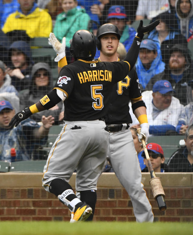 Pittsburgh Pirates' Josh Harrison, left, high fives Corey Dickerson ,right, after hitting a home run during the first inning of a baseball game against the Chicago Cubs on Sunday, June 10, 2018, in Chicago. (AP Photo/Matt Marton)