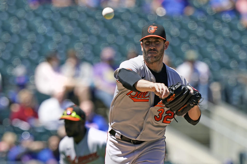 Baltimore Orioles starting pitcher Matt Harvey (32) throws to first to hold New York Mets runner Francisco Lindor on base during the third inning of a baseball game, Wednesday, May 12, 2021, in New York. (AP Photo/Kathy Willens)