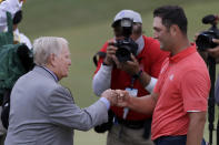 Jon Rahm, of Spain, right, is congratulated by Jack Nicklaus after winning the Memorial golf tournament, Sunday, July 19, 2020, in Dublin, Ohio. (AP Photo/Darron Cummings)