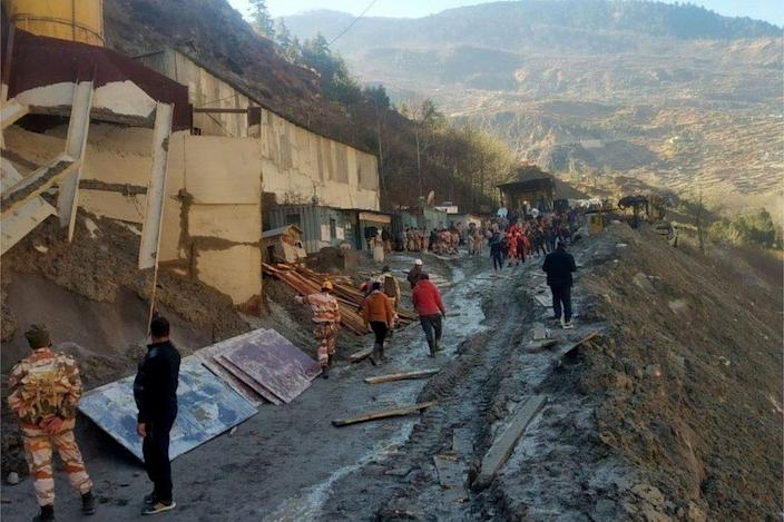 Rescue team members work outside a tunnel after a part of a glacier broke away and caused flood in Tapovan, northern state of Uttarakhand, India, February 8, 2021