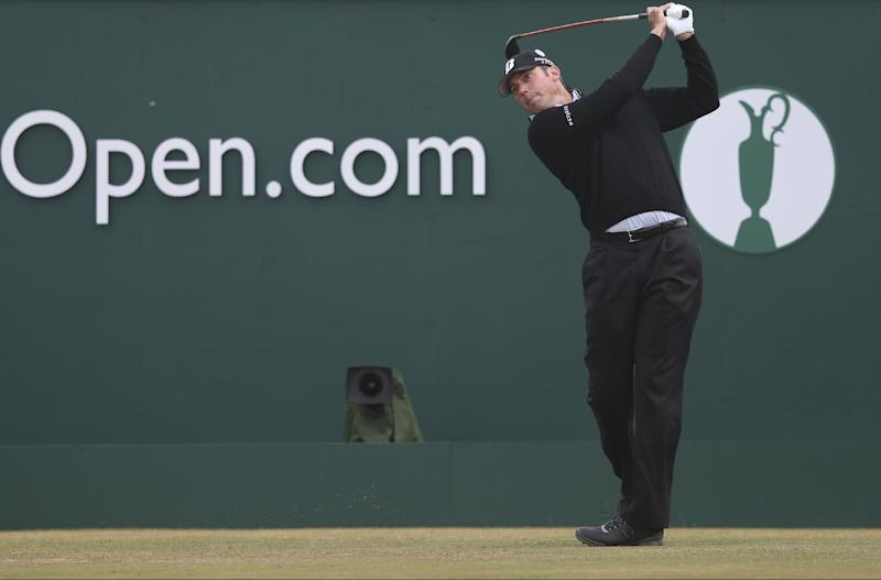 Matt Kuchar of the United States plays off the first tee during the final round of the British Open Golf Championship at Muirfield, Scotland, Sunday July 21, 2013. (AP Photo/Scott Heppell)