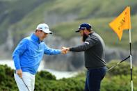 Andrew Johnston of England high fives Robert MacIntyre of Scotland on the 5th green during the first round of the 148th Open Championship held on the Dunluce Links at Royal Portrush Golf Club on July 18, 2019 in Portrush, United Kingdom. (Photo by Mike Ehrmann/Getty Images)