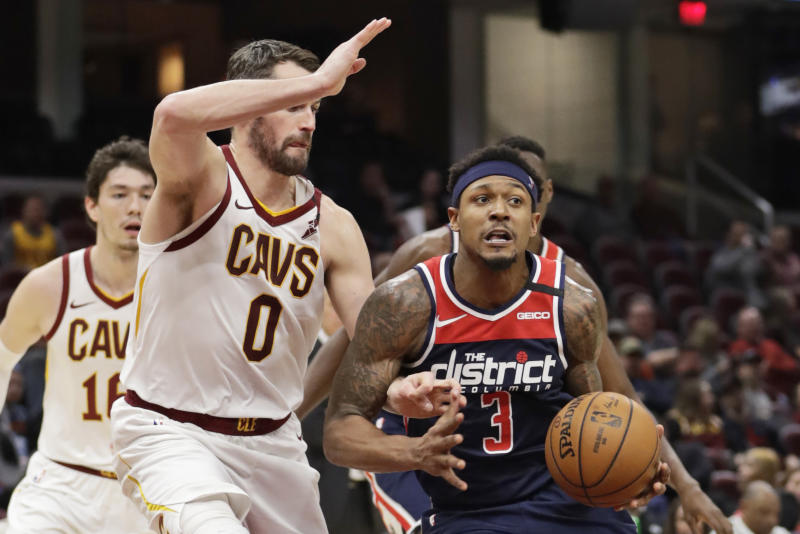 Washington Wizards' Bradley Beal (3) drives past Cleveland Cavaliers' Kevin Love (0) in the second half of an NBA basketball game, Thursday, Jan. 23, 2020, in Cleveland. Washington won 124-112. (AP Photo/Tony Dejak)