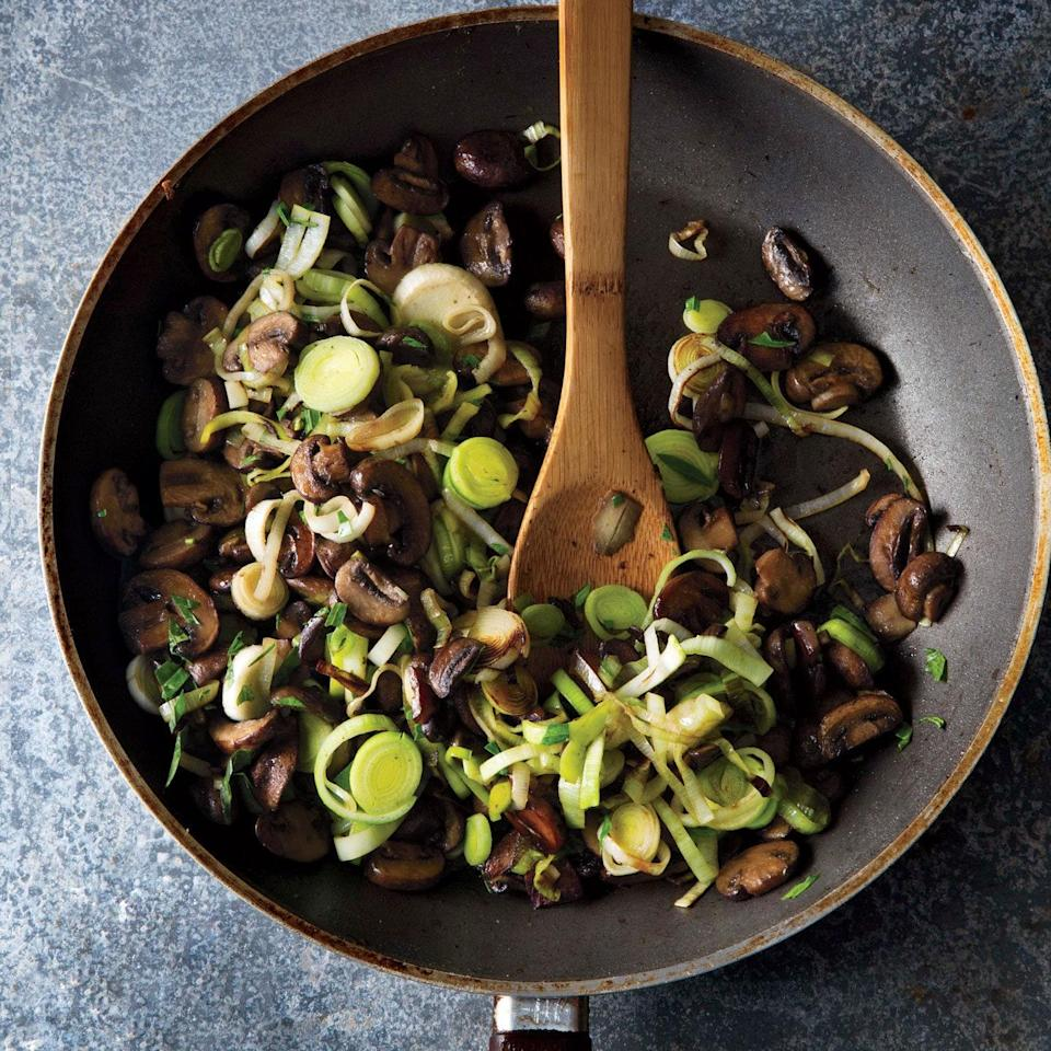 """The key to this simple side dish is to stir the mushrooms and leeks frequently enough so they caramelize without burning. Serve on top of a chop or a piece of salmon. <a href=""""https://www.epicurious.com/recipes/food/views/mushroom-and-leek-saute-51238850?mbid=synd_yahoo_rss"""" rel=""""nofollow noopener"""" target=""""_blank"""" data-ylk=""""slk:See recipe."""" class=""""link rapid-noclick-resp"""">See recipe.</a>"""