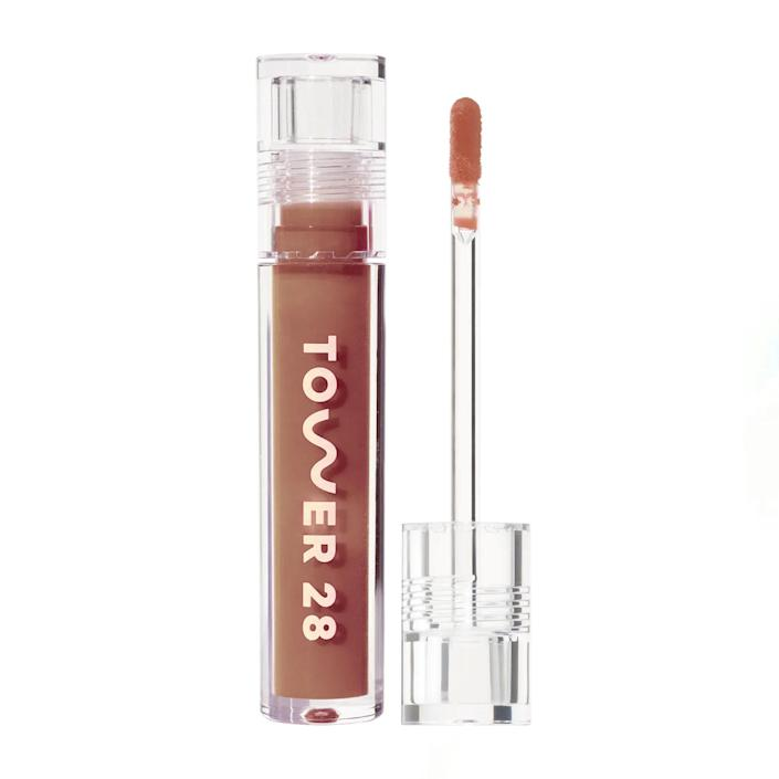 """Looking for something a bit creamier rather than super glossy? Tower28 has you covered. The brand considers this product a milky alternative to lip gloss, with the creamy nudes aptly named almond, cashew, coconut, and oat. The formula is nourishing while still offering a good amount of sheen—plus, there are enough shade options to flatter the full spectrum of skin tones. $14, Tower 28 Beauty. <a href=""""https://shop-links.co/1737958272884092871"""" rel=""""nofollow noopener"""" target=""""_blank"""" data-ylk=""""slk:Get it now!"""" class=""""link rapid-noclick-resp"""">Get it now!</a>"""