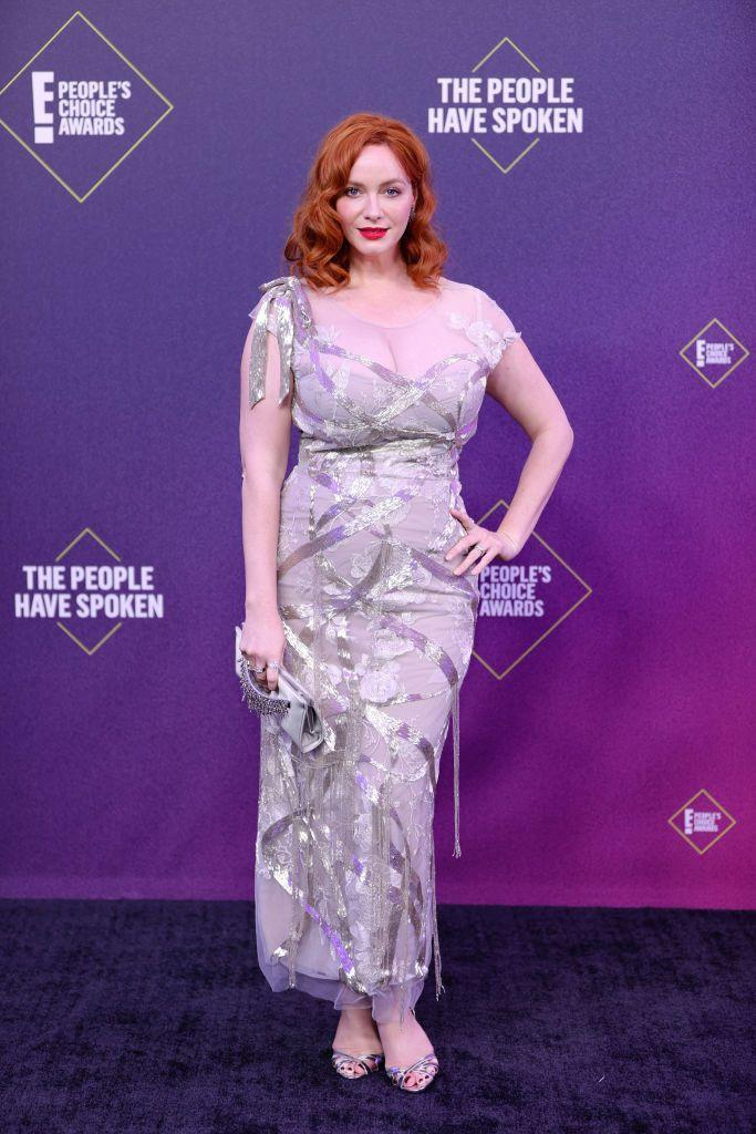 <p>Mad Men star Christina Hendricks indulged in a bit of glamour for the evening, wearing a sparkling silver dress by Marchesa. The actress teamed it with matching silver sandals, a silver clutch and some old Hollywood-inspired waves.</p>