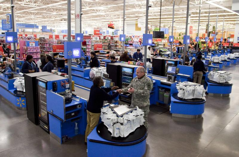 In this photo taken Dec. 15, 2010, the check-out inside a Wal-Mart store in Alexandria, Va., is shown. The battleground for the biggest fight in retailing today is being played out along this suburban highway. Going head-to-head: Wal-Mart against everyone else.  (AP Photo)