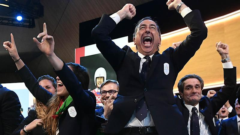 Mayor of Milan Giuseppe Sala and members of the delegation of Milan/Cortina celebrate. (Photo by PHILIPPE LOPEZ/AFP/Getty Images)