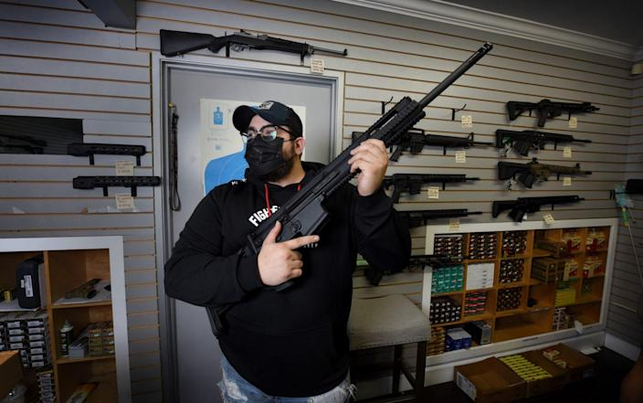 For gun salesmen like Issac Rodriguez, business is booming - Jeff Rayner/Coleman-Rayner