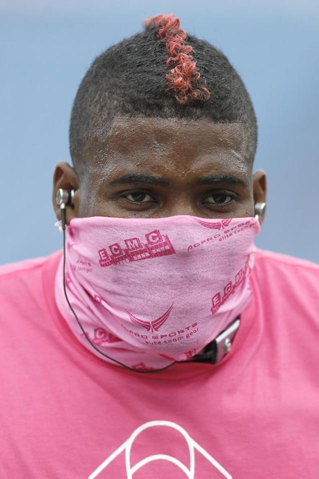 Buffalo Bills free safety Aaron Williams sports a pink mohawk as well as a pink bandana and shirt in support of breast cancer awareness as he warms up before an NFL football game against the Cincinnati Bengals on Sunday, Oct. 13, 2013, in Orchard Park, N.Y. (AP Photo/Gary Wiepert)