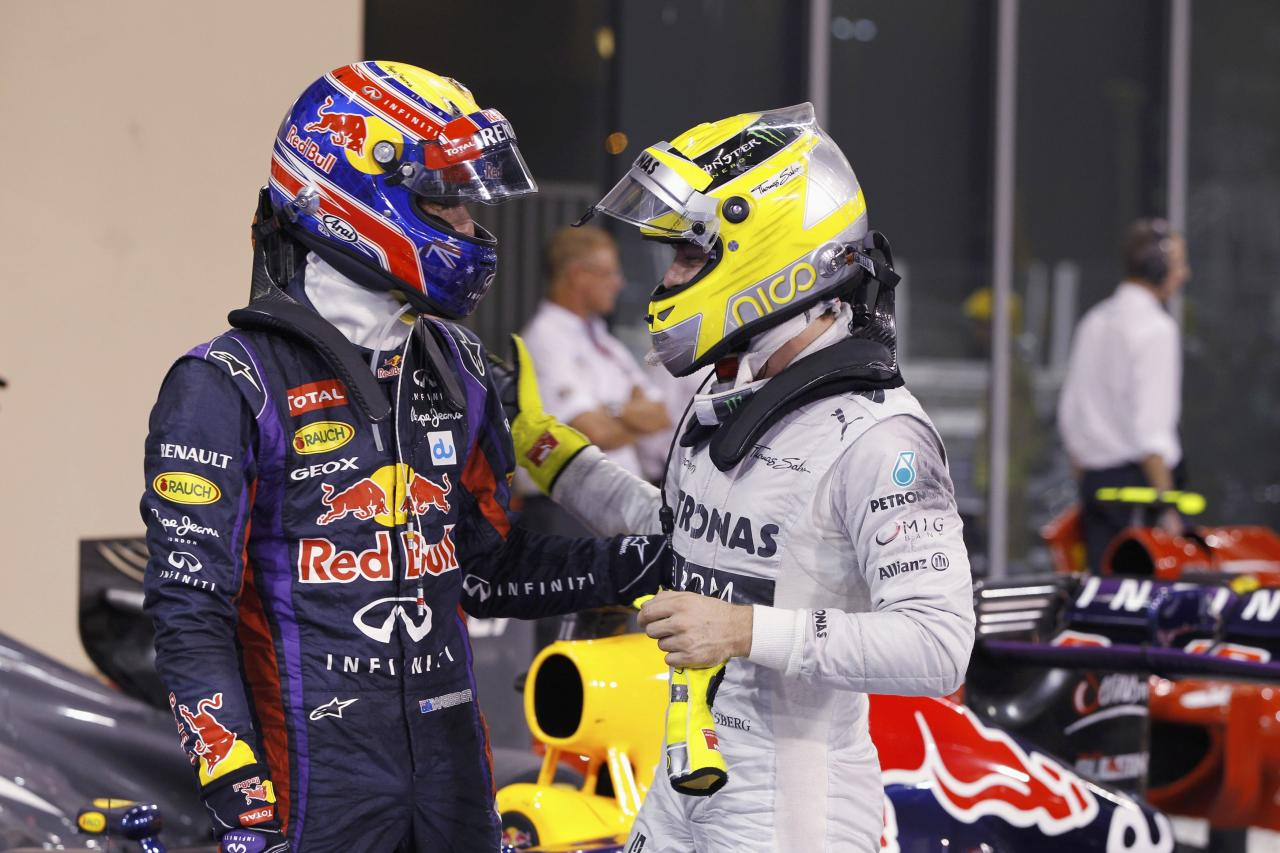 Red Bull Formula One driver Mark Webber of Australia (L) is congraluted by Mercedes Formula One driver Nico Rosberg of Germany after the qualifying session of the Abu Dhabi F1 Grand Prix at the Yas Marina circuit on Yas Island, November 2, 2013. Webber put Red Bull on pole position for the floodlit Abu Dhabi Formula One Grand Prix on Saturday in a front row sweep with quadruple world champion team mate Sebastian Vettel. REUTERS/Caren Firouz (UNITED ARAB EMIRATES - Tags: SPORT MOTORSPORT F1)