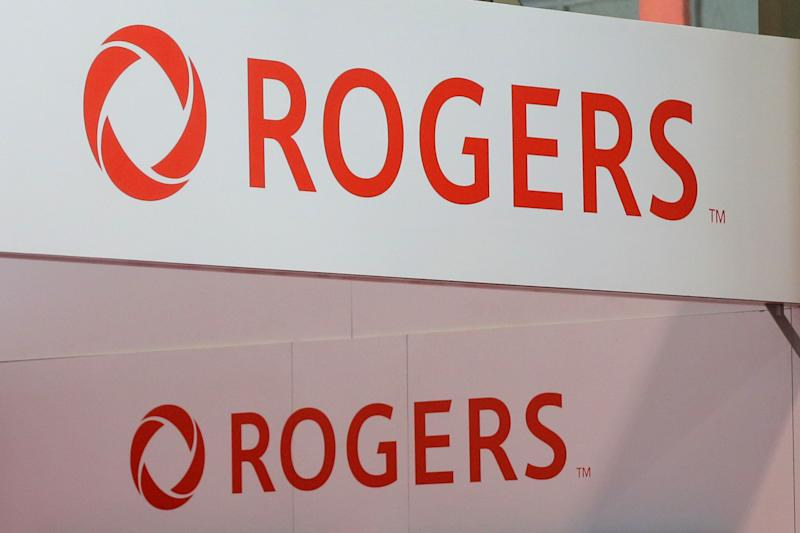 Rogers Communications logos are seen above a booth during the media day at the Canadian International AutoShow in Toronto, Ontario, Canada, February 14, 2019. REUTERS/Chris Helgren