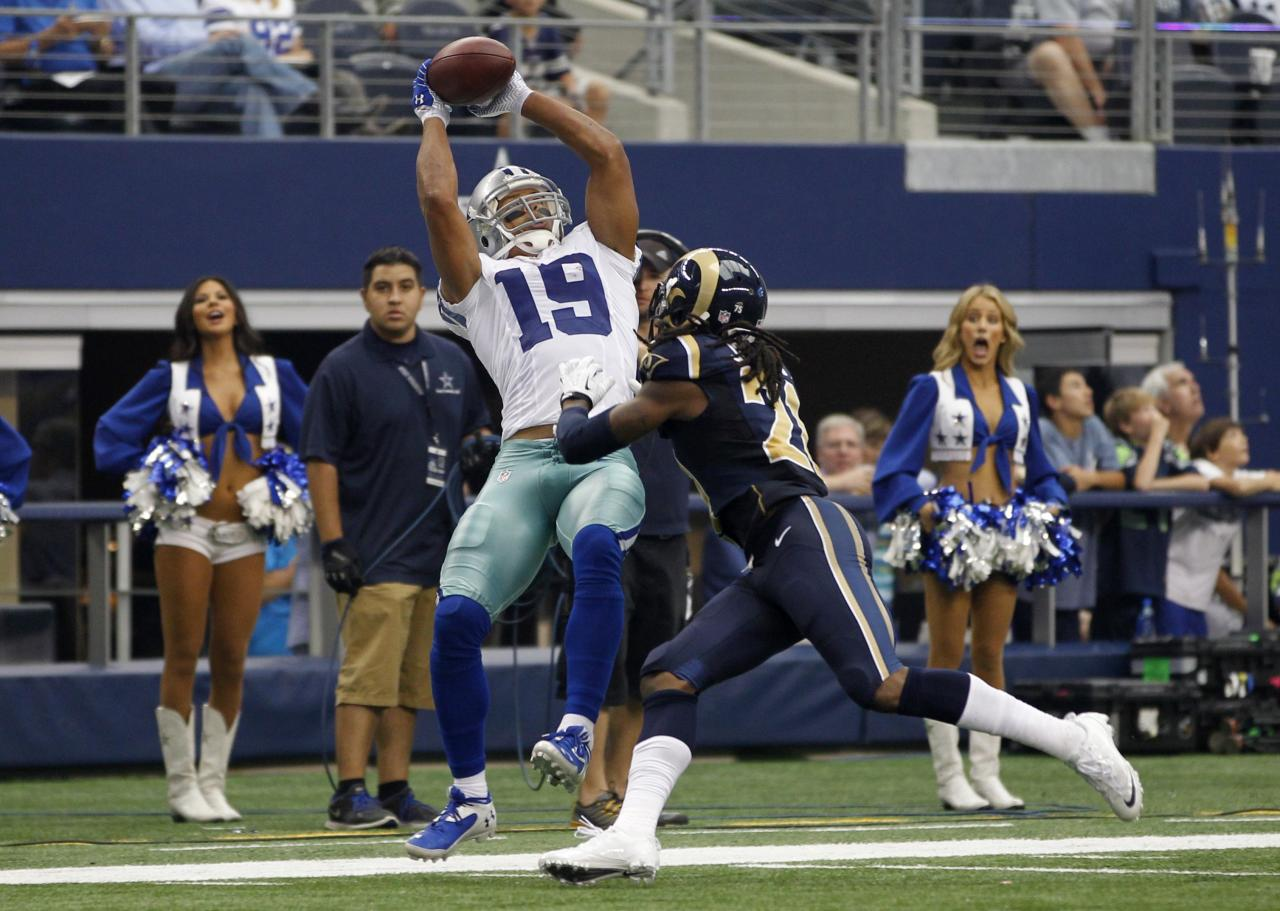 Dallas Cowboys wide receiver Miles Austin (19) goes up for the catch as he is defended by St. Louis Rams corner back Janoris Jenkins in the second half of their NFL football game in Arlington, Texas September 22, 2013. REUTERS/Mike Stone (UNITED STATES - Tags: SPORT FOOTBALL TPX IMAGES OF THE DAY)