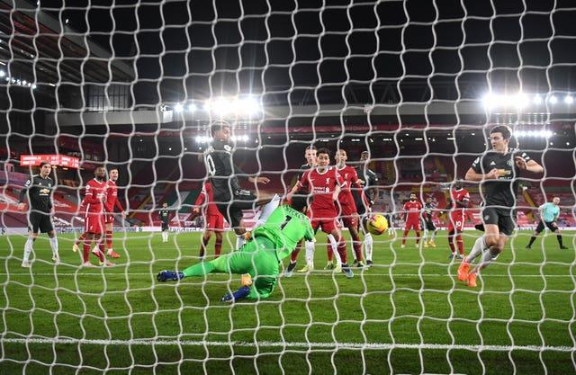 Goalkeeper Alisson Becker came to his side's rescue to preserve Liverpool's unbeaten home league record in a goalless draw against Manchester United