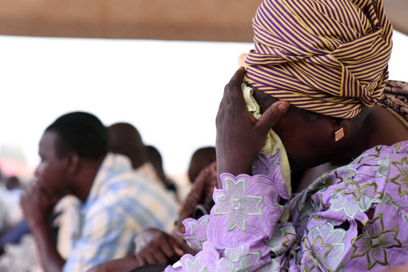 FILE PHOTO: Family members of victims of an ambush on workers near a Canadian-owned mine, react during their meeting with officials in Ouagadougou