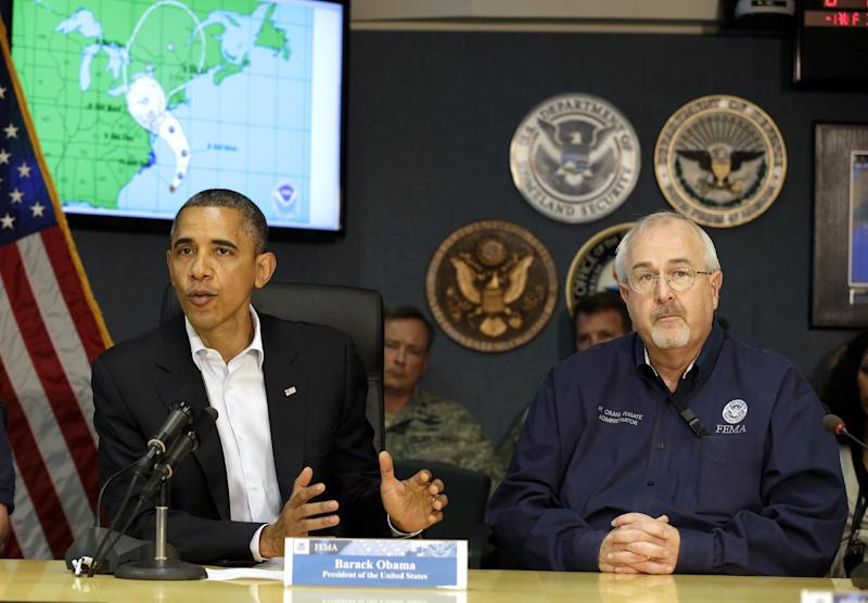 President Barack Obama speaks as he attends a briefing with Federal Emergency Management Agency administrator Craig Fugate, right, at the National Response Coordination Center at FEMA Headquarters in Washington, Sunday, Oct. 28, 2012.(AP Photo/Jacquelyn Martin)