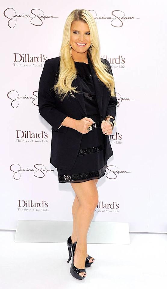 Last but not least ... we have Jessica Simpson, who was spotted promoting the release of her lucrative fashion and beauty lines at Dillard's department store in New Orleans. Are you a fan of the singer-turned-designer's style? I secretly am!    Check out last week's gallery here!    Follow 2 Hot 2 Handle creator, Matt Whitfield, on Twitter!  Kevin Mazur/WireImage.com - October 8, 2011