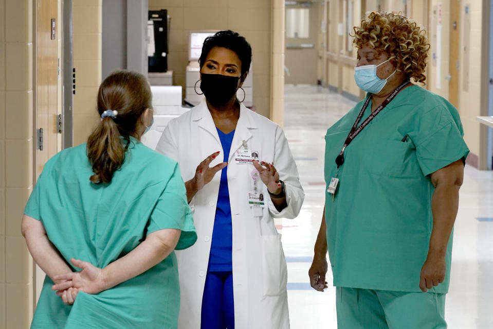 Dr. Rita McGuire, an obstetrician and infection control specialist at Roseland Community Hospital talks Friday, Jan. 29, 2021, with staff members about taking the COVID-19 vaccine. McGuire says countering misinformation and mistrust about vaccinations is a daily battle. Many workers ''have not forgotten about those studies where they used us as experiments,'' McGuire said, including the infamous Tuskegee research on Blacks with syphilis. (AP Photo/Charles Rex Arbogast)