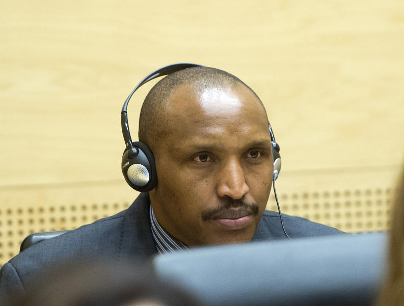 Bosco Ntaganda awaits the start of a hearing at the International Criminal Court (ICC) in The Hague, Netherlands, Monday Feb. 10, 2014. Judges at the ICC are weighing whether there is enough evidence to proceed to trial in the case against Bosco Ntaganda, the former leader of a rebel group in Congo's unstable eastern region. Prosecutor Fatou Bensouda accused Ntaganda of 13 charges of war crimes and 5 charges of crimes against humanity for acts including murder, rape, persecution and recruiting child soldiers. Ntaganda's lawyers have said he is innocent of any wrongdoing. (AP Photo/Toussaint Kluiters, Pool)