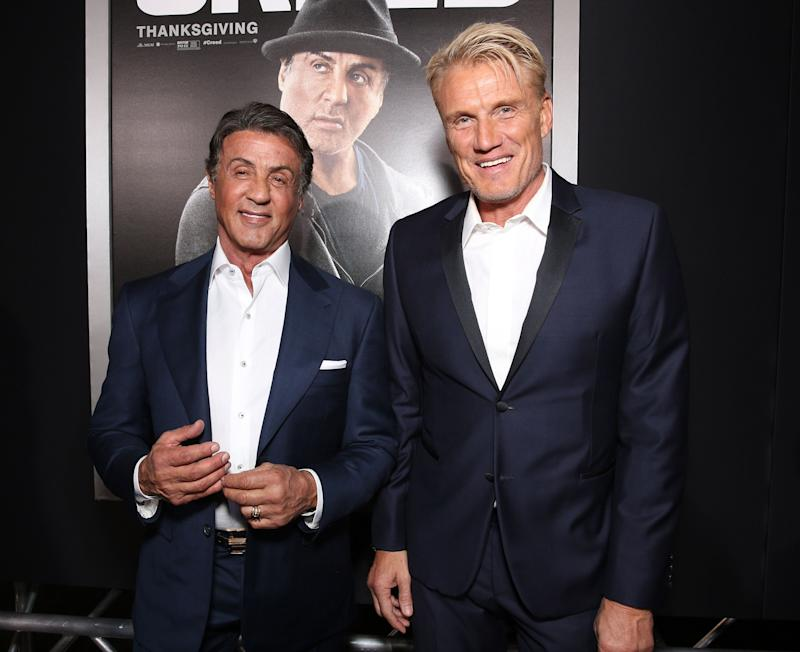 "Stallone and Lundgren attend the premiere of ""Creed"" in 2015. (Photo: Todd Williamson via Getty Images)"