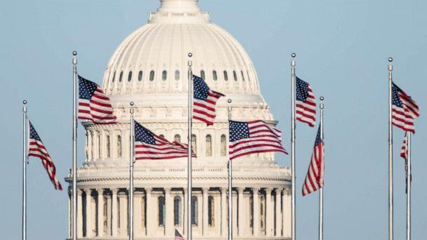 PHOTO: The U.S. Capitol dome is seen behind the American flags at the base of the Washington Monument in Washington, March 29, 2021. (Bill Clark/CQ-Roll Call via Getty Images, FILE)
