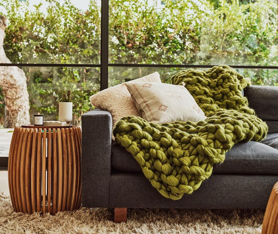 """Finding <a href=""""https://www.glamour.com/gallery/best-throw-blankets?mbid=synd_yahoo_rss"""" rel=""""nofollow noopener"""" target=""""_blank"""" data-ylk=""""slk:a throw blanket"""" class=""""link rapid-noclick-resp"""">a throw blanket</a> that looks good in <em>any</em> space is no easy task—until we came across this olive green one that has the <a href=""""https://www.glamour.com/story/queer-eye-tan-france-is-now-an-american-citizen?mbid=synd_yahoo_rss"""" rel=""""nofollow noopener"""" target=""""_blank"""" data-ylk=""""slk:Tan France"""" class=""""link rapid-noclick-resp"""">Tan France</a> seal of approval. $220, Etsy. <a href=""""https://www.etsy.com/listing/852842730/tan-france-x-etsy-chunky-knit-blanket?"""" rel=""""nofollow noopener"""" target=""""_blank"""" data-ylk=""""slk:Get it now!"""" class=""""link rapid-noclick-resp"""">Get it now!</a>"""
