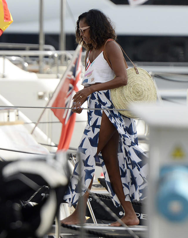 Former first lady Michelle Obama boards a yacht in style. (Photo: Splash)