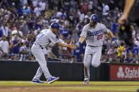 Los Angeles Dodgers' Steven Souza, right, slaps hands with third base coach Dino Ebel as Souza rounds the bases after hitting a home run against the Arizona Diamondbacks during the eighth inning of a baseball game Friday, June 18, 2021, in Phoenix. (AP Photo/Ross D. Franklin)