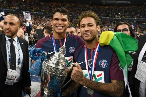 Brazilian superstar Neymar, pictured here with his Paris Saint-Germain and international teammate Thiago Silva, is the biggest name in the French league